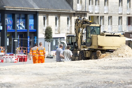 municipality: workers working for upgrade to residential street. Stock Photo