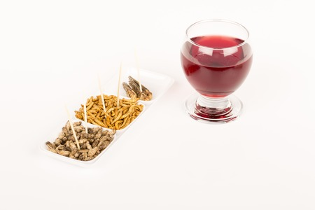 Fried crickets locust molitor insects with glass of wine, food of future rich protein France 免版税图像