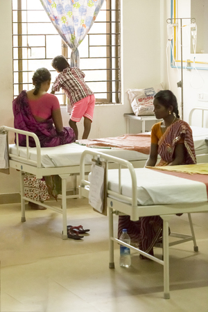 hospitalized: Documentary Editorial. Pondicherry Jipmer hospital, India - June 1 2014. Full documentary about patient and their family. While children are hospitalized, Families waiting eating outdoor Editorial
