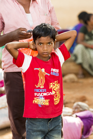 documentary: Documentary Editorial. Pondicherry Jipmer hospital, India - June 1 2014. Full documentary about patient and their family. While children are hospitalized, Families waiting eating outdoor Editorial