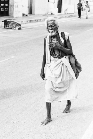 beggar: beggar, homeless writing in the street, India, Tamil Nadu