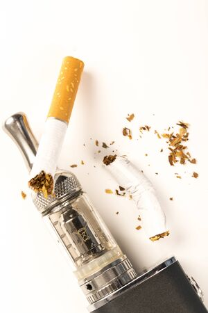 electronic cigarettes and tabacco on white background stop smoking message Stock Photo