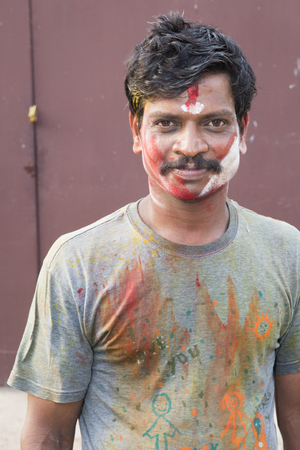 Pondicherry, Tamil Nadu,India - May 15, 2014 : each year in villages, people celebrate the temple fest, for the full day. They walk in groups, they launch paint on people, play music. Editoriali