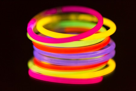 an ultraviolet: colorful neon light fluorescent disco bright ultraviolet
