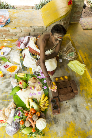 benares: Documentary image. Pondichery, Tamil Nadu, India. May 27, 2014. Puja Thila homa with french lady and priest, brahman to pray about died man.
