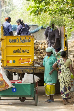 Illustrative image. Pondicherry, Tamil Nadu, India - March 03, 2014. Household waste pastic pick up in the village. Women workers Plastic bottles, papers, bin Editorial