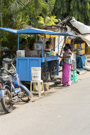 Illustrative image. Pondicgery, Tamil Nadu, India - Marsh 10., 2014. Shop of food, restaurant in the street itinerant trade small merchant Editorial
