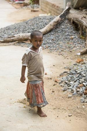 Illustrative image. Pondicherry, Tamil Nadu, India - April 21, 2014. Poor child with sad feeling, in the street Editorial