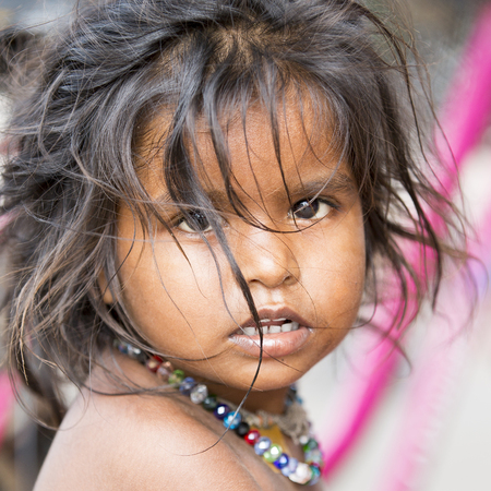 Illustrative image. Pondicherry, Tamil Nadu, India - April 21, 2014. Poor child with sad feeling, in the street 新闻类图片