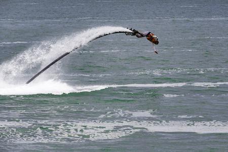 propulsion: Illustrative editorial image. a fly board rider at sea Editorial