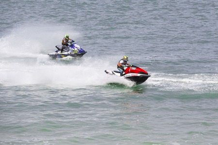 sur: Veulette sur mer, Normandy, France - May 28, 2017. Unidentified competitors are riding jet ski boat for a race, championship France. Jet in motion