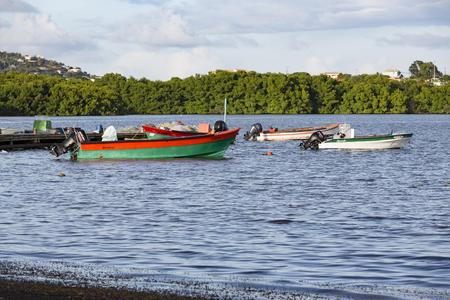 La Trinit , Martinique - April 10, 2017. Colored wood boats floating on the Caraibe sea.