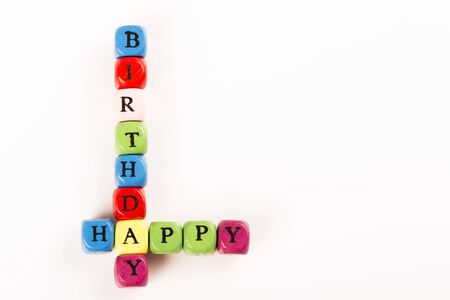 happybirthday: Baby Blocks spelling the words HAPPY BIRTHDAY colored letter cube Stock Photo