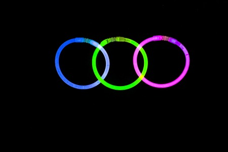 glow stick: Glow sticks neon light fluorescent on back background. variation of different colored chem lights
