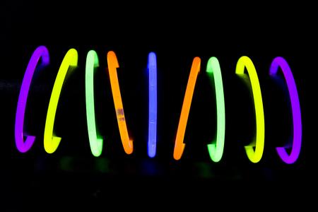 Bracelet jewel made with glow sticks neon light fluorescent on back background. Nightclub cocktail bar atmosphere 写真素材