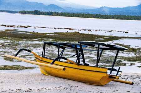 float cloud: Traditional typical wood boat at Bali, indonesia, with blue sea