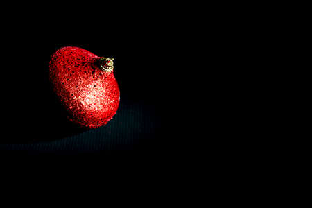 christmas red ball on black background. Uncluttered style Stock Photo