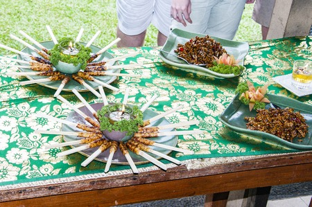Plates of delicious meals of Bali on table