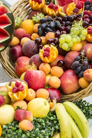 Composition of assortment of fresh fruits in baskets