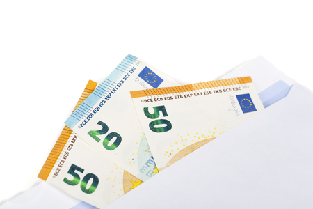 White envelope full of euro banknotes bills onwhite background. Concept of corruption, drug and bribery. Front and top view