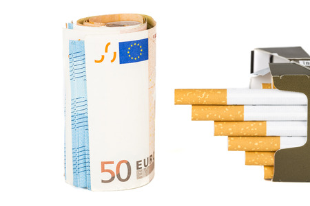 20 and 50 Euro banknotes bills cash with cigarettes, increase graph made with cigarettes. Concept of cost of tabacco, cigarettes. Front and top view, close-up.