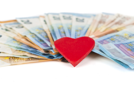 prostituta: Red heart on euro banknotes bills. On white background. love and money