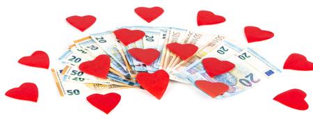 prostituta: Corazón rojo en billetes de los billetes de euro. En el fondo blanco. amor y dinero Foto de archivo