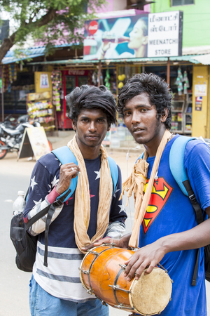 hinduist: PONDICHERY, PUDUCHERY, INDIA - AUGUST 28, 2017. Unidentified christians, catholics, hinduists people, with orange dress, pilgrims walk from chennai to Velanganni, for annual pilgrimage at the church of Velankanni. They walk more than 250 kilometers.