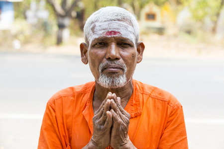 TIRUVANNAMALI, TAMIL NADU, INDIA - MARCH Circa, 2018 . Portrait Sadhu at Ashram Ramana Maharshi. Sadhu is a holy man, who have chosen to live an ascetic life and focus on the spiritual practice of Hinduism. Sage, Moksha, Maya, caste, Shiva, Vishnou, gymno