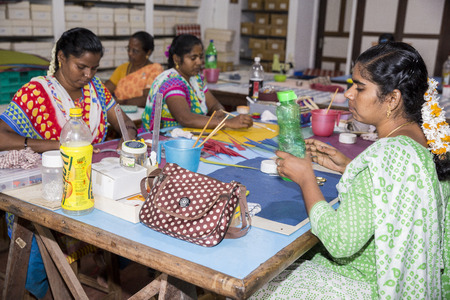 PUDUCHERY, PONDICHERY, TAMIL NADU, INDIA - March circa, 2018. Unidentified female women man artist make jeweleries paper and flowers paper by hand.