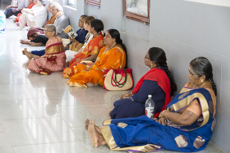 Ashram of Sri Ramana Maharshi, Tiruvannamalai, Tamil Nadu, India - March circa, 2018. Unidentified woman and man sitting on the floor of ashram, to meditate, spirituality.