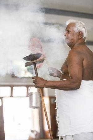 Ashram of Sri Ramana Maharshi, Tiruvannamalai, Tamil Nadu, India - March circa, 2018. Unidentified woman and man walking turning around the ashram to meditate, to ptay, spirituality. Ritual action