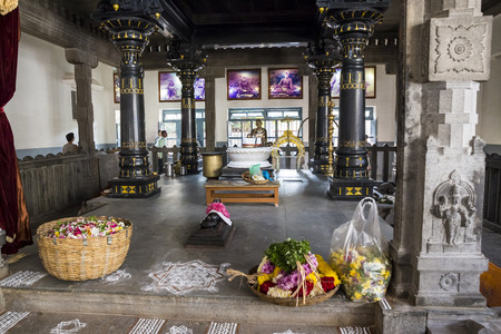 Ashram of Sri Ramana Maharshi, Tiruvannamalai, Tamil Nadu, India - March circa, 2018. Unidentified woman and man ceremony in the ashram to meditate, to ptay, spirituality. Ritual action