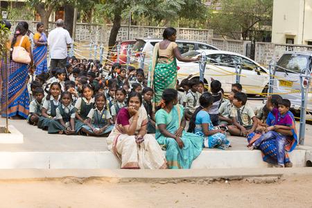 Ashram of Sri Ramana Maharshi, Tiruvannamalai, Tamil Nadu, India - March circa, 2018. Unidentified woman and man around the ashram to meditate, to ptay, spirituality. Ritual action