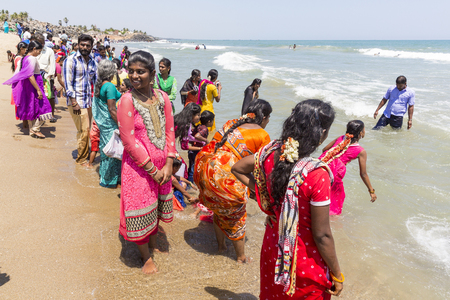 MASI MAGAM FESTIVAL, PUDUCHERY, PONDICHERY, TAMIL NADU, INDIA - March 1, 2018. Group of unidentified Indian pilgrims women men bathing in the sea, on the beach Editorial