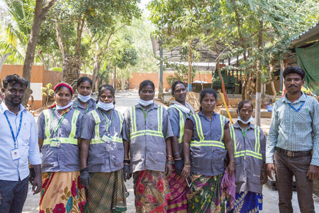 PUDUCHERY, PONDICHERY, TAMIL NADU, INDIA - March circa, 2018. The team of women and men who work in a recycling center. The huge of waste, garbage send from the factory to recycling process. This is the best way for protect the world for global warming. V