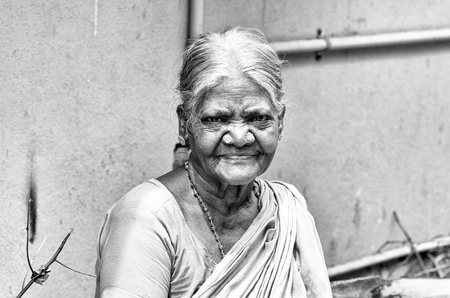 PONDICHERY, PUDUCHERRY, TAMIL NADU, INDIA - SEPTEMBER CIRCA, 2017. Portrait of an unidentified Indian old senior poor woman with saree in the street, looking serious sad Stock Photo - 120103541