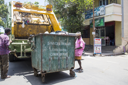 PONDICHERY, PUDUCHERRY, TAMIL NADU, INDIA - March circa, 2018. Unidentified workers of recycling garbage collector truck loading waste and trash bin