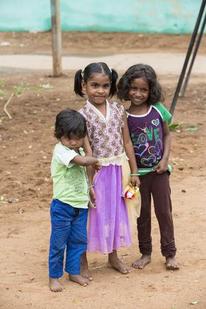 PONDICHERY, PUDUCHERRY, TAMIL NADU, INDIA - MARCH CIRCA, 2018. Unidentified happy smiling poor rural children teenagers playing at street of village Pondichery