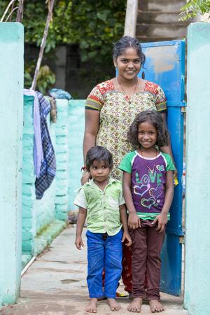 PONDICHERY, PUDUCHERRY, TAMIL NADU, INDIA - SEPTEMBER CIRCA, 2017. Portrait of a unidentified happy woman with children outdoors