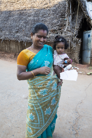 PONDICHERRY, PUDUCHERRY, TAMIL NADU, INDIA - March Circa, 2018. Unidentified poor child with mother in the street of village