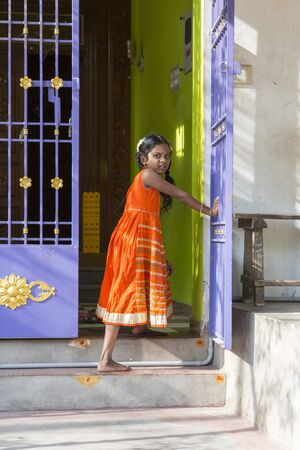 PONDICHERY, PUDUCHERRY, TAMIL NADU, INDIA - SEPTEMBER Circa, 2017. An unidentified poor girl in a small village, outdoor, looking at the camera Editorial