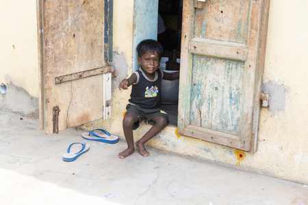 PONDICHERY, PUDUCHERRY, TAMIL NADU, INDIA - SEPTEMBER CIRCA, 2017. Portrait of unidentified Indian poor kid boy is smiling outdoor in the street Stock Photo - 120103794