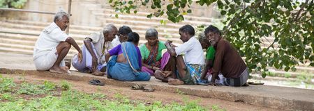 PONDICHERY, PUDUCHERRY, TAMIL NADU, INDIA - SEPTEMBER CIRCA, 2017. Group of unidentified men and women playing traditional indian boardgame Ashta Chamma, another name of ancient game Chowka Bhara. On