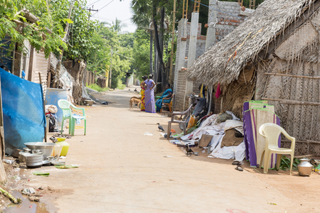 PONDICHERY, PUDUCHERRY, TAMIL NADU, INDIA - SEPTEMBER CIRCA, 2017. Unidentified rural people in front of their house at village, An Indian rural scene.