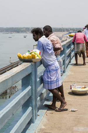 Unidentified local people saling street food on the road on the bridge