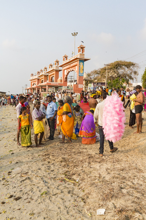RAMESHWARAM, TAMIL NADU, INDIA- MARCH CIRCA 2018. At the gate, Unidentified Hindu pilgrims people ready to go to the bath in the Arabian Sea before entering the temple. Great time of all the families