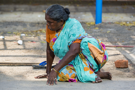 RAMESHWARAM, TAMIL NADU, INDIA - MARCH CIRCA, 2018. Portrait of an unidentified homeless woman in the street of the sacred city of Rameshwaram, India. Redakční