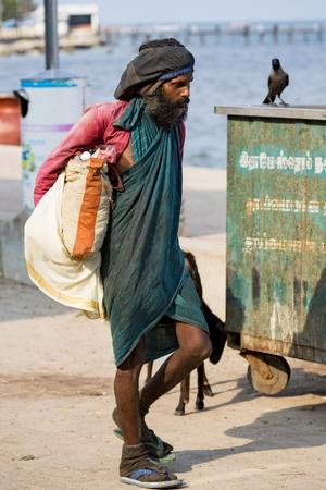 RAMESHWARAM, TAMIL NADU, INDIA - MARCH CIRCA, 2018. Portrait of an unidentified homeless man in the street of the sacred city of Rameshwaram, India.
