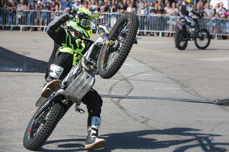 LE TRAIT, SEINE MARITIME, NORMANDY, FRANCE - SEPTEMBER 01, 2018. Moto-show in central square of city. Tricks on ATV stuntmen, Stunt Riding - Wheelie, Stoppie and extreme acrobatics somersault on motorbike. Outdoor spectacle